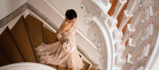 Bride on winding stairs